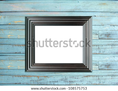 Black Vintage picture frame, wood plated, blue wood background, clipping path included - stock photo