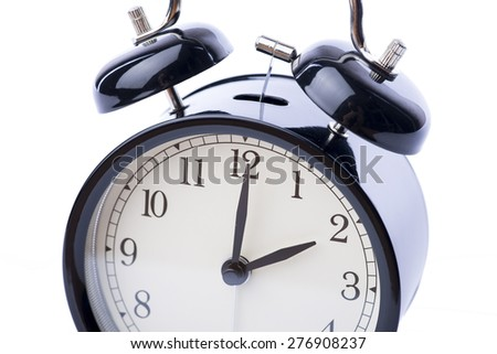 Black vintage style alarm clock over the white background, isolated - stock photo