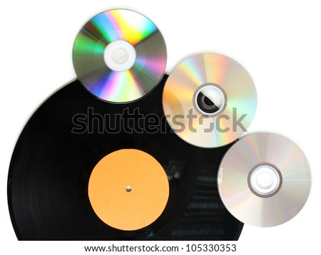 Black vinyl record and CD disks isolated on white - stock photo