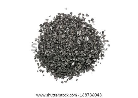 Black Volcanic Salt Pile On White Background - stock photo