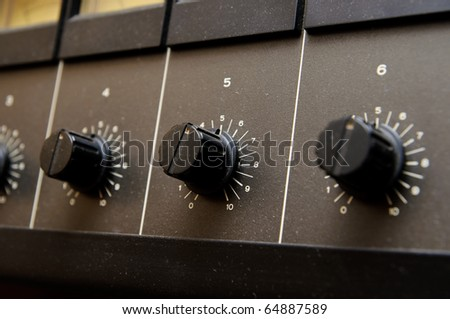 Black volume knobs - stock photo