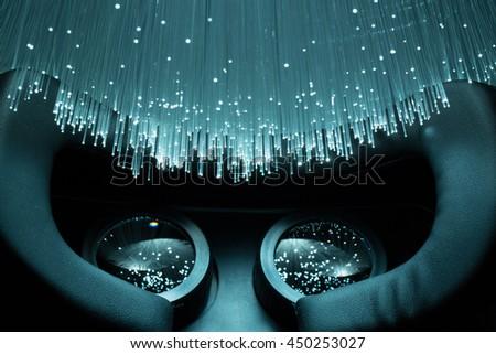 Black VR headset and Fiber optics background  - stock photo