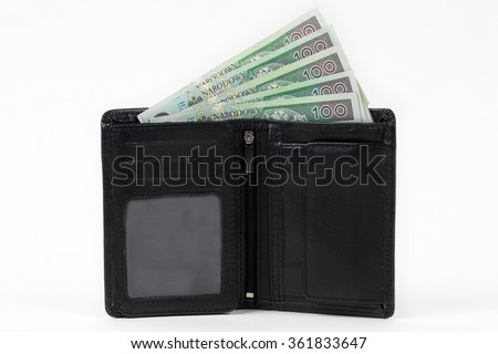 Black walet with polish money  - stock photo