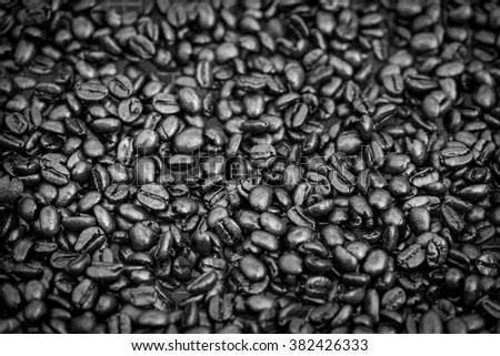 Black & white dark roasted coffee bean background - stock photo