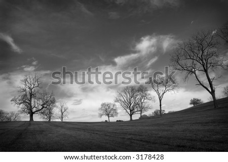 black & white landscape with dramatic clouds - stock photo