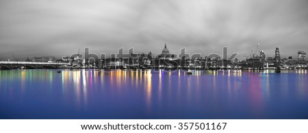 Black & White Panorama of London with Thames river in colors at sunrise - stock photo