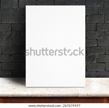 Black White paper poster lean at black brick wall and marble table,Template mock up for adding your text. - stock photo