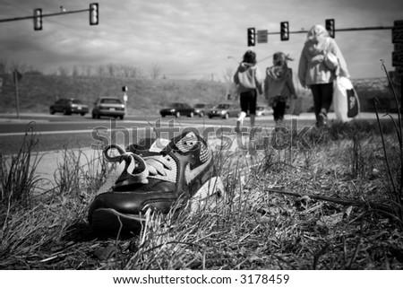black & white photograph of and abandoned shoe - stock photo