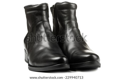 Black winter boots for men isolated on white background - stock photo