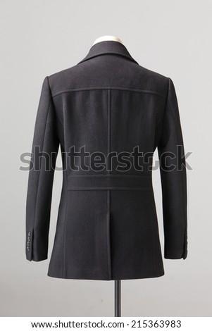 black winter coat isolated on gray background - stock photo