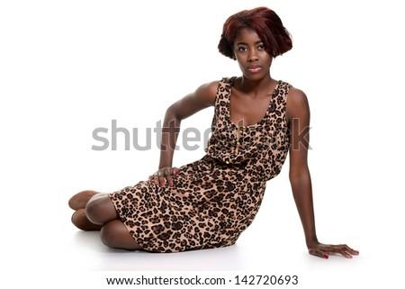 black woman wearing animal print dress - stock photo