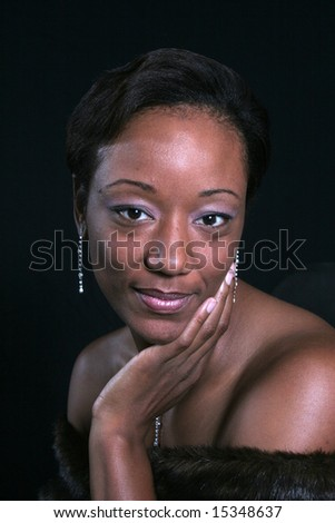 Black woman with hand on her chin - stock photo