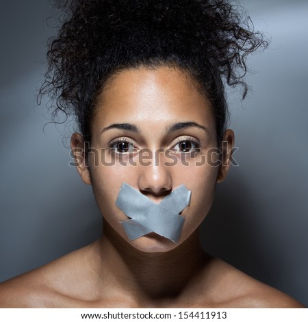 black woman with mouth covered with tape. Concept of forbidden opinion - stock photo