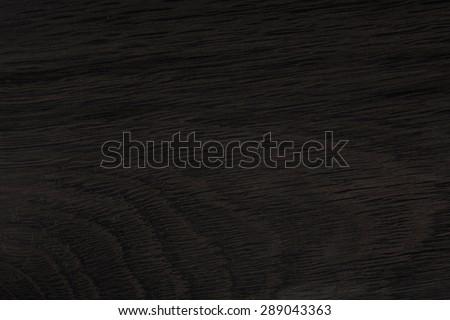 Black wood. Expensive ebony texture. Textufe from natutal old oak. - stock photo