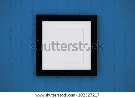black wood frame on the wall - stock photo