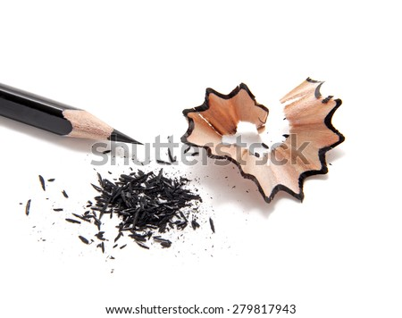 Black wooden pencil with sharpening shavings, isolated on white.Studio shot. - stock photo