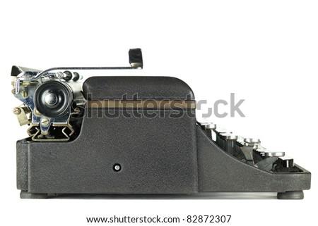 Black worn vintage typewriter on white background - stock photo