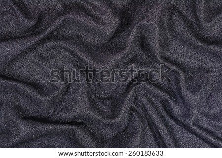 Black wrinkled nonwoven fabric texture background - stock photo