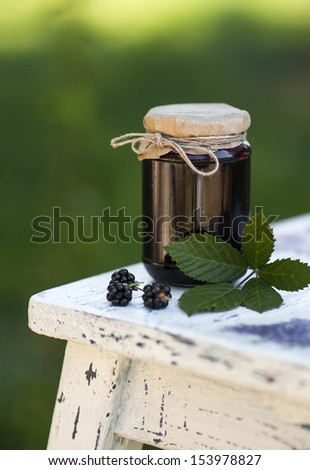 Blackberry jam in a jar - stock photo