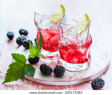 Blackberry Lemonade on a vintage wooden board - stock photo