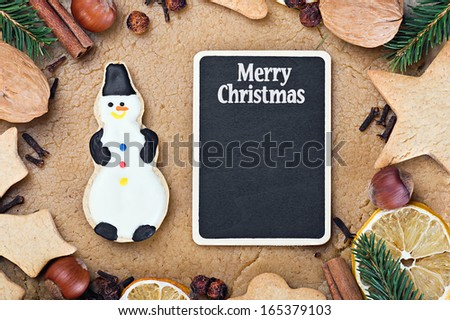blackboard and ingredients for cooking and baking Christmas cookies - stock photo