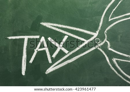 blackboard drawing above shows one scissors cut taxes - stock photo