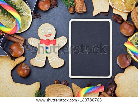 blackboard for gifts and ingredients for cooking and baking Christmas cookies - stock photo