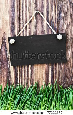 blackboard hanging on the door - stock photo