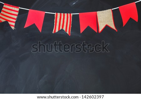 Blackboard texture background. Empty blank black chalkboard with chalk traces decorated by flags - stock photo