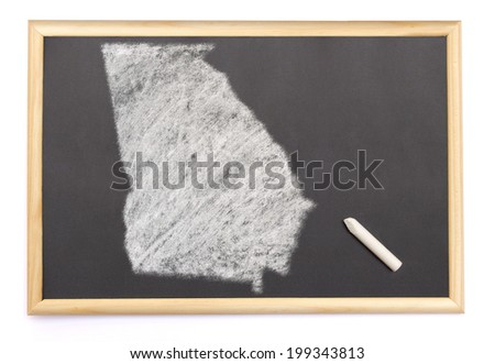Blackboard with a chalk and the shape of Georgia drawn onto. (series) - stock photo