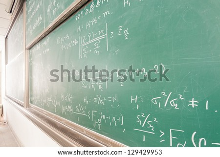 blackboard with complicated  math formulas - stock photo
