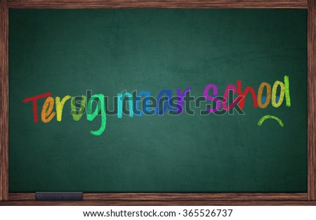 Blackboard with dutch words for back to school and sad face - stock photo