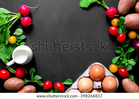Blackboard with organic products, view from above - stock photo