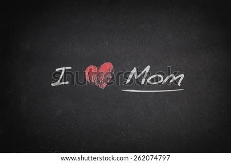 Blackboard with phrase, I love mom. - stock photo