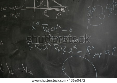 Blackboard with Physics (Theoretical Quantum Mechanics) Equations - stock photo