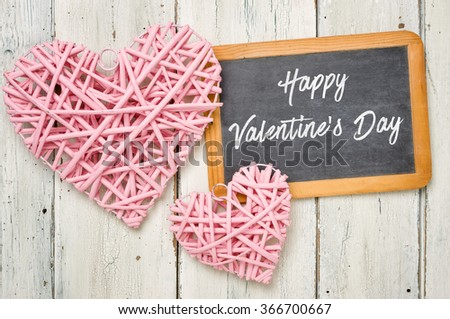 Blackboard with pink hearts - Happy Valentines Day - stock photo