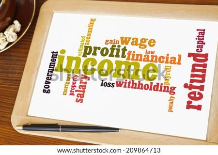 blackboard with tax word cloud - stock photo