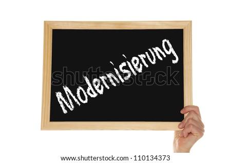 blackboard with the german word modernization - stock photo