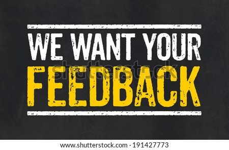 Blackboard with the text We want your feedback - stock photo