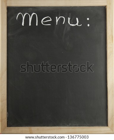 "Blackboard with the word ""menu"" in the high part - stock photo"