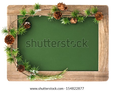 blackboard with wooden frame and christmas decoration isolated on white background. antique chalkboard with place for your text - stock photo