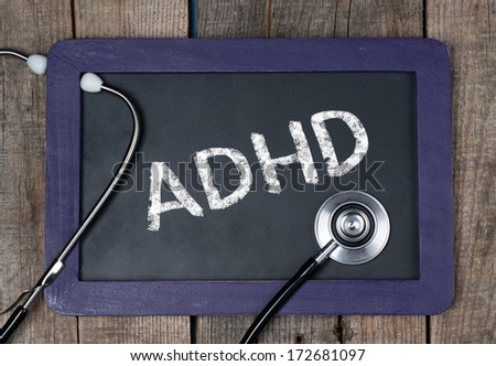 Blackboard with word ADHD and stethoscope - stock photo