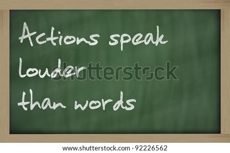"Blackboard writings "" Actions speak louder than words "" - stock photo"
