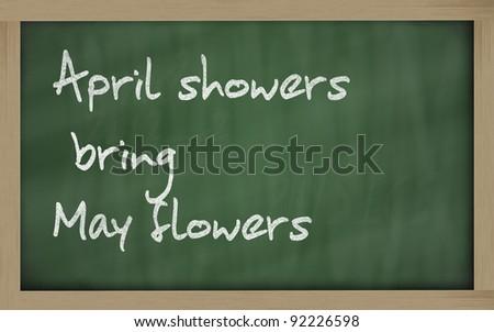 "Blackboard writings "" April showers bring May flowers "" - stock photo"