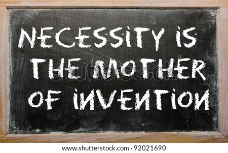"""Blackboard writings """"Necessity is the mother of invention"""" - stock photo"""