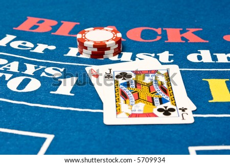Blackjack hand on a blackjack table - stock photo