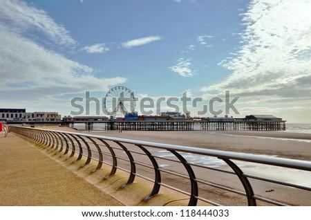 Blackpool promenade with the pier. - stock photo