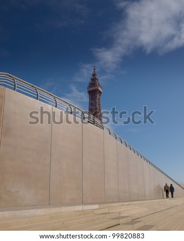 Blackpool tower with old and new sea wall - stock photo