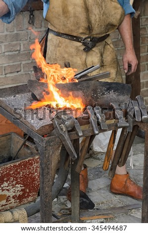 blacksmith at work in the repair shop in italy - stock photo