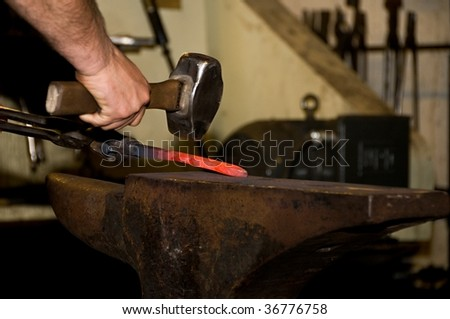 Blacksmith in a Workshop - stock photo